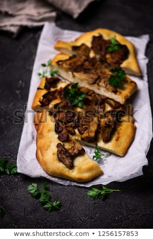 Wild mushroom pizza.. Top view. selective focus stock photo © zoryanchik