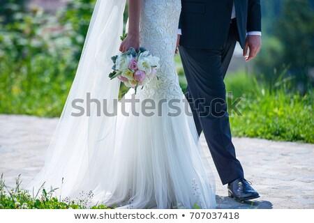 Сток-фото: Groom In Blue Suit And Bride Wearing Wedding Dress