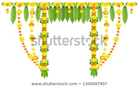 Garland for door of mango leaves and marigold flowers. Ugadi or gudi padwa indian lunar new year Stock photo © orensila