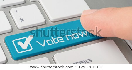 A keyboard with a blue labeled button - Vote now Stock photo © Zerbor
