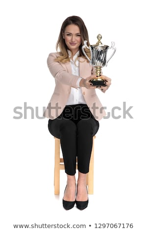 blonde businesswoman sits on wooden stool and offers cup stock photo © feedough