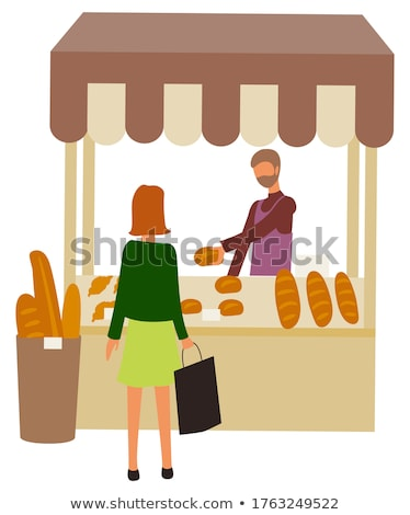 bread and buns in basket showcase of bakery seller stock photo © robuart