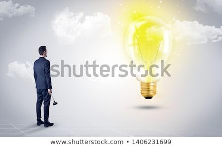 Férfi néz Föld földgömb szívesség üzletember Stock fotó © ra2studio