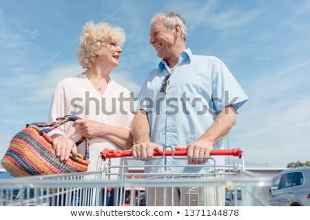 Senior uomo carrello guardando moglie Foto d'archivio © Kzenon