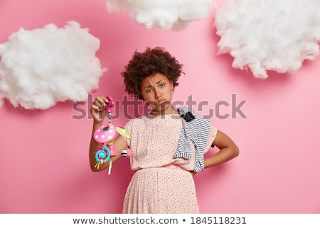 young woman with healthy skin posing isolated over pink background with eyes closed stock photo © deandrobot