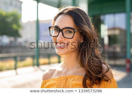 Portrait of attractive brunette woman with eyeglasses wearing re Stock photo © dashapetrenko