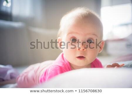 прелестный ребенка мальчика живота белый диване Сток-фото © lichtmeister