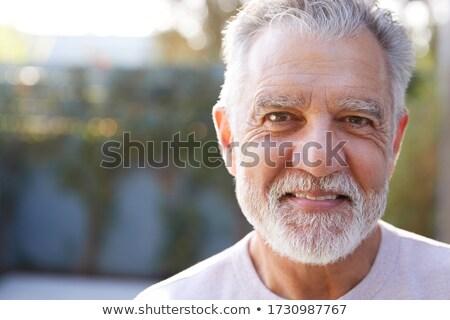 Close- up of senior man looking at camera in garden on a sunny day Stock photo © wavebreak_media