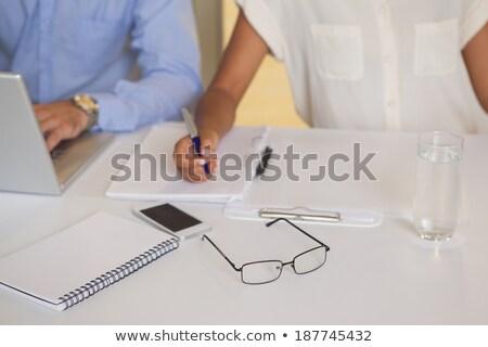 Métis gens d'affaires écrit notepad affaires Photo stock © wavebreak_media
