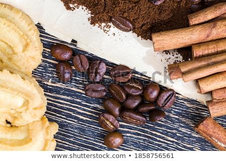 Chocolate dark muffins with sugar powder, cinnamon sticks and mi Stock photo © marylooo