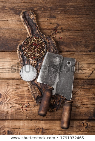 Vintage hatchet for meat on wooden chopping board with salt and pepper on wooden table background.  Stock photo © DenisMArt