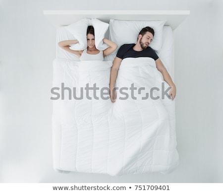 Infeliz mujer cama dormir hombre Foto stock © dolgachov