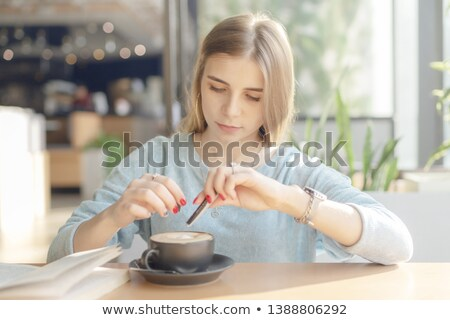 close up of woman adding sugar to cup of tea Stock photo © dolgachov
