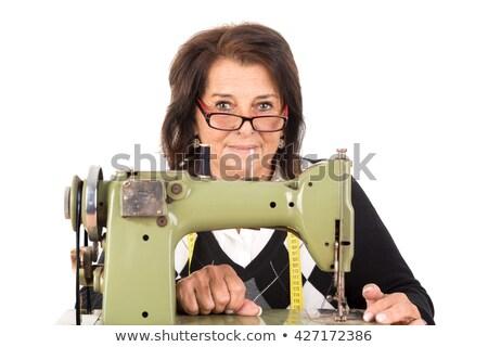 Portret naaimachine exploitant lang witte blouse armen Stockfoto © pressmaster