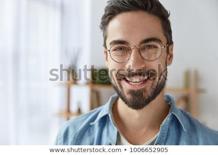 Tiro atraente masculino restolho óculos Foto stock © vkstudio
