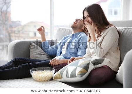 Paar eten popcorn kijken films home Stockfoto © robuart