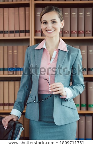 Attorney at law in her office in front of book shelf Stock photo © Kzenon