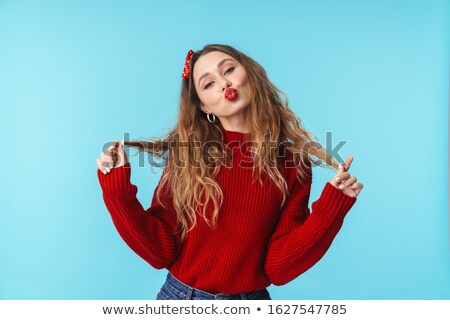 Image of amusing caucasian woman in headband making kiss lips Stock photo © deandrobot