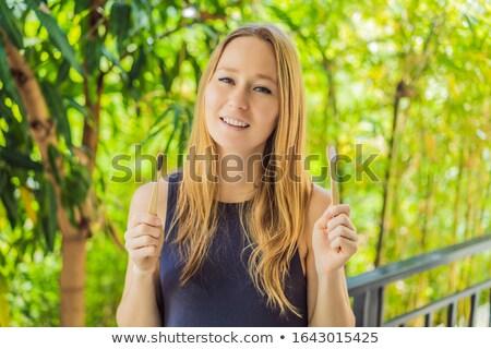 Bambusz fogkefe zöld növekvő mosoly fa Stock fotó © galitskaya