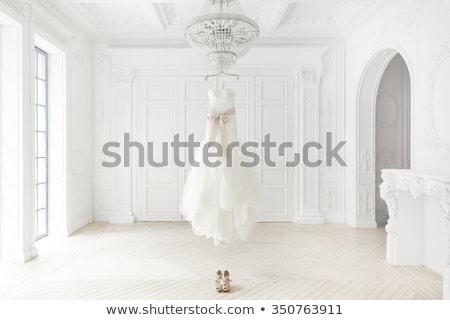 Gyönyörű fehér menyasszonyi ruha akasztás ablak virág Stock fotó © ruslanshramko