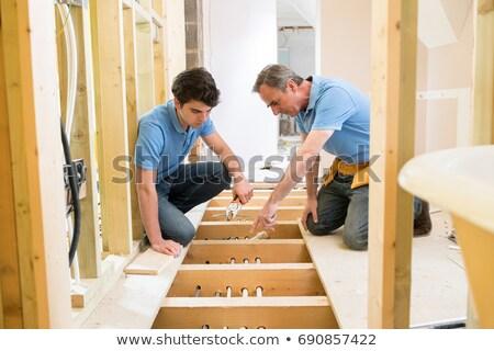 Man twee pijpen samen gebouw tools Stockfoto © photography33