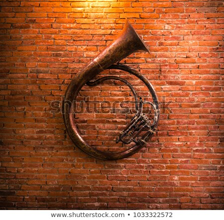trumpet on brick wall background stock photo © mahout