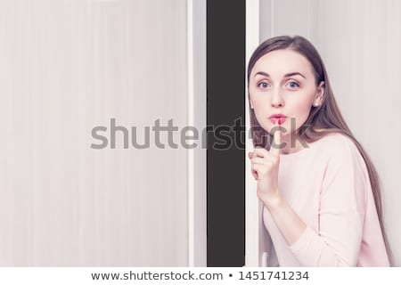 Woman holding her index finger to her lips Stock photo © photography33