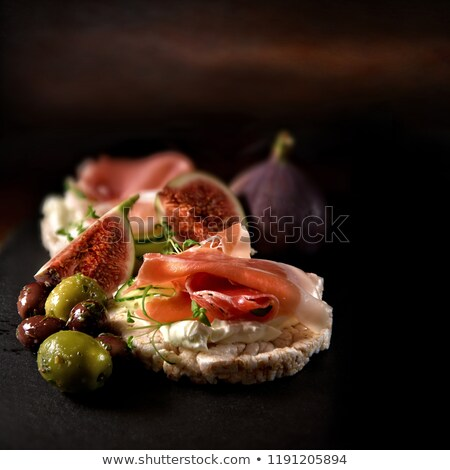 Stock photo: figs and cured ham, fingerfood