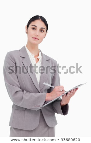 Tradeswoman writing on a clipboard Stock photo © photography33