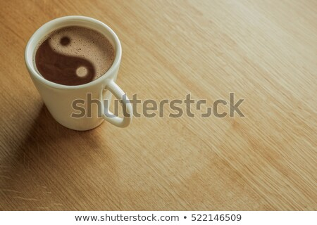 Cup of coffee with Yin Yang symbol Stock photo © gladiolus