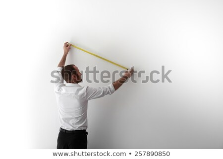 Plumber measuring a wall Stock photo © photography33