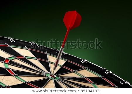 Stock photo: Dart sticks to bullseye on a dart board