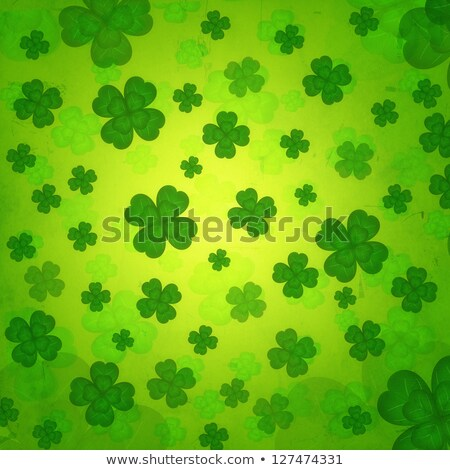striped four-leaved shamrocks in green old paper background Stock photo © marinini