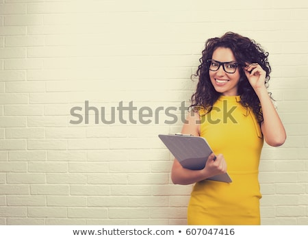 young woman fits on yellow dress stock photo © ssuaphoto