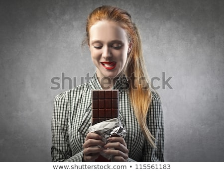 Gourmand woman eating chocolate Stock photo © photography33