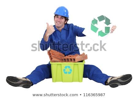 Kereskedő promótál újrahasznosítás férfi építkezés munka Stock fotó © photography33