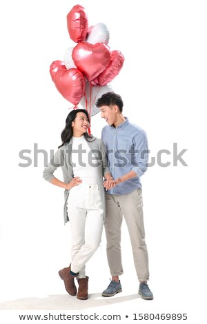 casual man with balloons and hands on hips stock photo © feedough