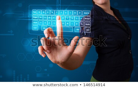 Young girl is choosing the keyboard. Stock photo © d13