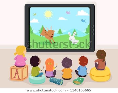 Dzieci oglądanie telewizji dwa posiedzenia kanapie dzieci Zdjęcia stock © sdenness