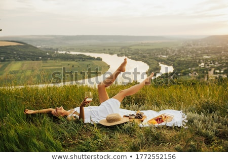 Lovely caucasian woman in yellow dress laying down on white Stock photo © pxhidalgo