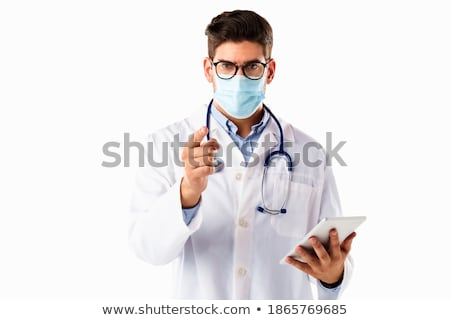 portrait of a male doctor showing finger at you on white stock photo © vlad_star