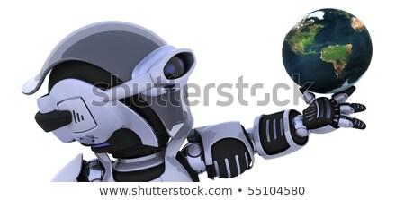 Robot Inspecting A Globe Stockfoto © Kjpargeter