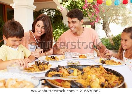 Family eating paella Stock photo © photography33