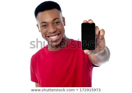 Young guy displaying brand new cellphone Stock photo © stockyimages