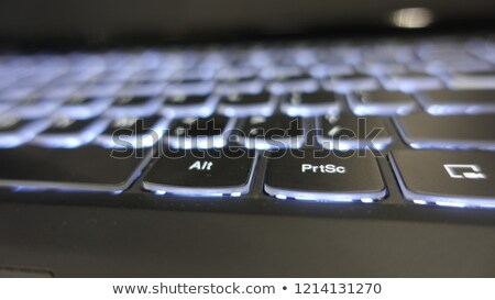 Close up of white keyboard  with glowing blue enter button Stock photo © jenbray