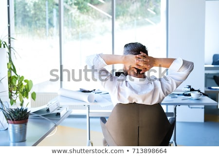 businessman stretching in his office chair stock photo © nito