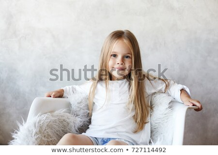 Güzel genç bayan oturma sandalye bakıyor Stok fotoğraf © FAphoto