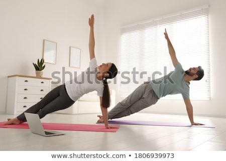 Couple yoga plage homme mer Photo stock © HASLOO