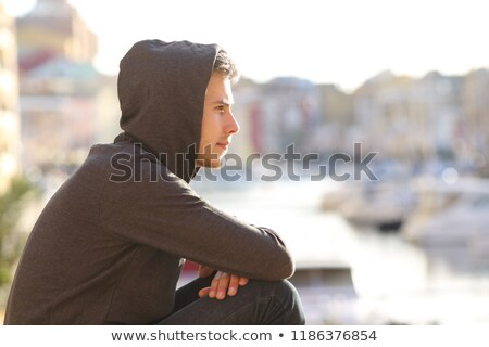Jovem masculino ao ar livre moço cerca Foto stock © JamiRae
