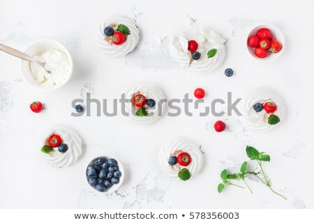 Strawberries with fresh cream and meringue Stock photo © raphotos